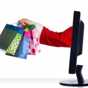 santa clause sticking hand out of monitor with gifts